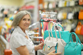 Old lady in store — Stock Photo