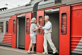 Elderly couple at train station — Stock Photo