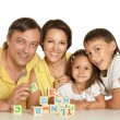 Family playing with cubes — Stock Photo #54911739