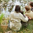 Family relaxing near lake — Stock Photo #54911955