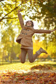 Woman jumping in park — Stock Photo