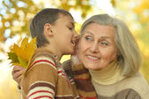 Grandmother and grandson in park — Stock Photo