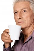 Elderly man with cup — Stock Photo