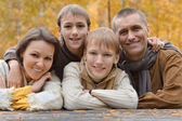 Family in autumn forest — Stock Photo