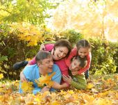 Happy family in autumn park — Stock Photo