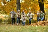 Happy family in autumn forest — Stockfoto