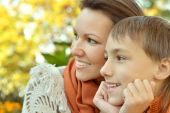 Beautiful mother with son in park — Stock Photo