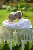 Senior couple sitting in chair — Stock Photo