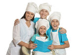 Happy female chef with assistants — Stock Photo