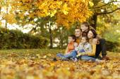Happy family in autumn forest — Photo