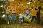 Happy family in autumn forest — Stock Photo