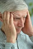 Thinking senior man at home — Stock Photo