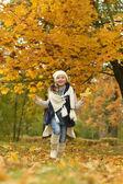 Girl in autumn park — Stock Photo