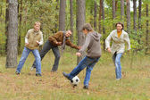 Family play football forest — Stock Photo