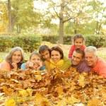 Family in autumn park — Stock Photo #56806529