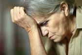 Sad aged woman — Stock Photo