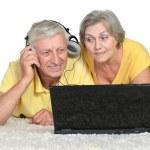 Senior couple with laptop — Stock Photo #57888097