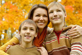 Mother and sons in  park — Stock Photo