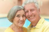 Senior couple by pool — Foto de Stock