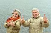 Senior couple  near lake — Foto de Stock