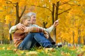 Grandfather with boy in autumn park — Foto Stock