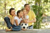 Family and socker ball — Stock Photo