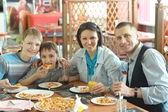 Family eating pizza in cafe — Stock Photo