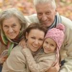 Family in  autumn park — Stock Photo #59850955