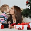 Mother and little boy near Christmas tree — Stock Photo #59851031