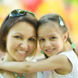 Mother with daughter in park — Stock Photo #59851115