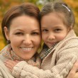 Mother with daughter in park — Stock Photo #59851221