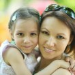 Mother with daughter  in park — Stock Photo #59851285