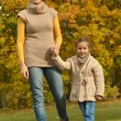 Mother with daughter in park — Stock Photo #59852103