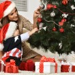 Mother with boy near Christmas tree — Stock Photo #59852497
