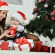 Mother with boy near Christmas tree — Stock Photo #59852629