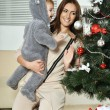 Mother with boy near Christmas tree — Stock Photo #59853015