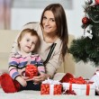 Mother with boy near Christmas tree — Stock Photo #59853219