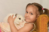 Girl with a rabbit — Stock Photo
