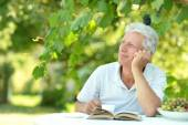 Older man with book — Stock Photo