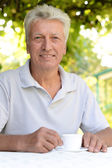 Elderly man  with cup of coffee — Stock Photo