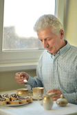 Elderly man with cup of tea — Stock Photo