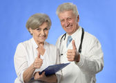Senior doctors show thumbs up — Stock Photo