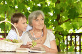 Grandmother with  grandson reading — Stock Photo