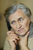 Senior woman calling  doctor — Stock Photo
