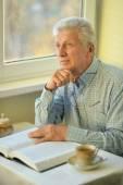 Senior man with book — Stock Photo