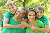 Cheerful family  in the summer park — Stock Photo