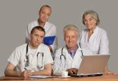 Doctors at the table  with laptop — Stock Photo