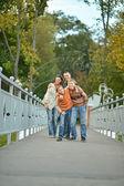 Family walking in park — Stock Photo