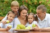 Family of five eating fruits — Stock Photo