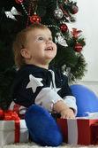 Little boy  near new-year tree — Stock Photo